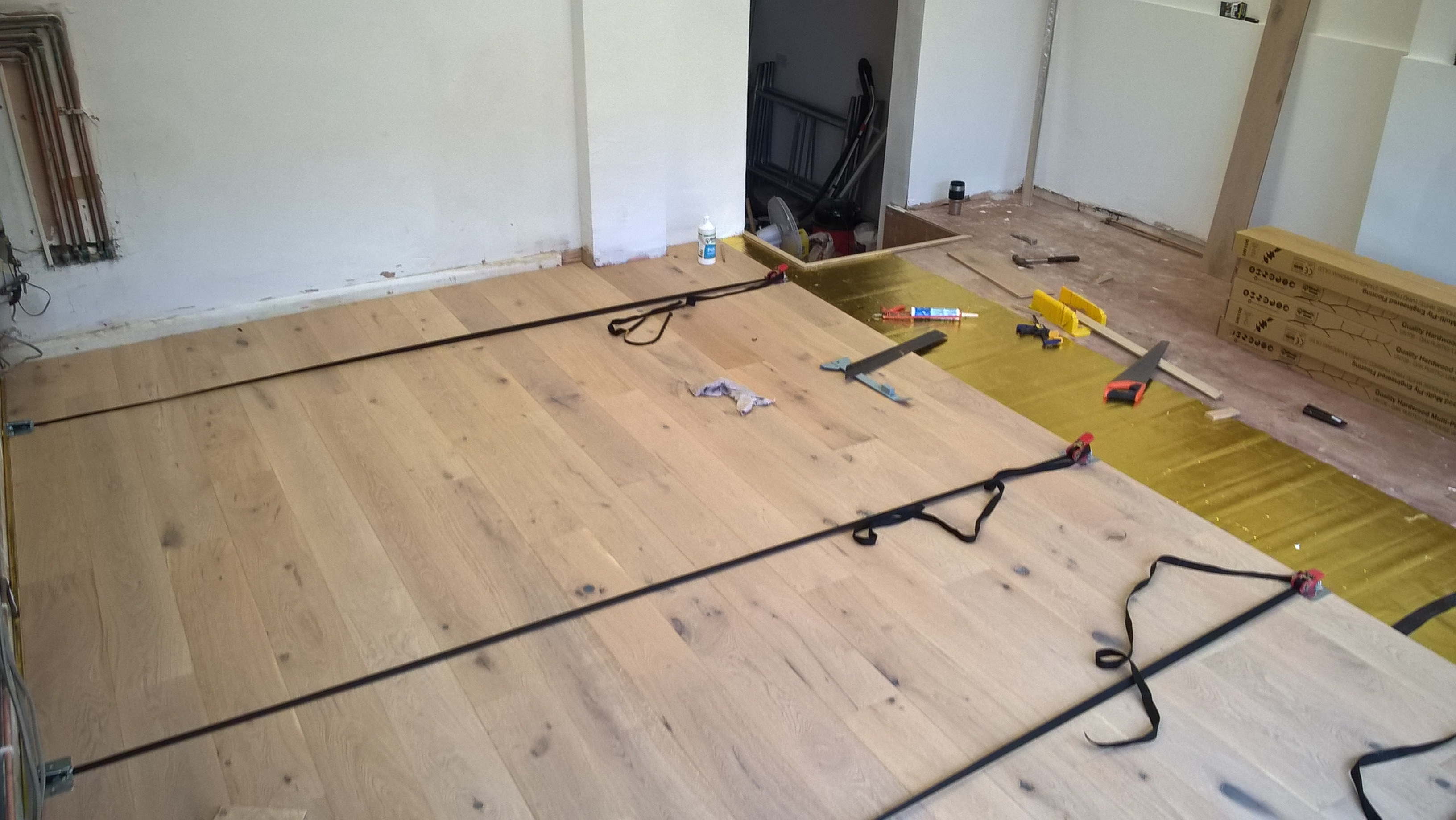 Solid wood flooring strapped together